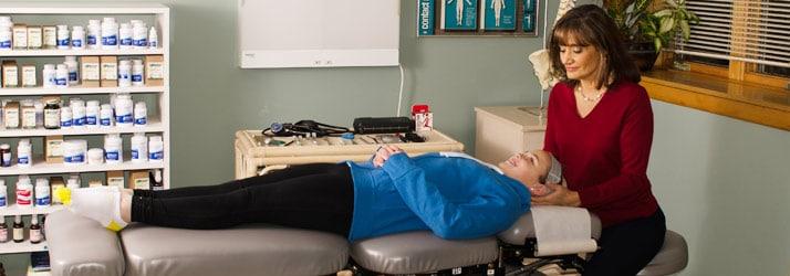Chiropractor Eden Prairie MN Olinda Floro doing neck adjustment